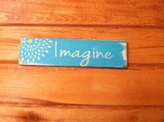 A personal favorite from my Etsy shop https://www.etsy.com/listing/217774907/imagine-sign-13w-x-3-12-tall-hand