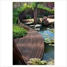 Curved fence: Pond garden with centrepiece ribbon of woven rebar steel, deck area for sitting, wildflower meadow mat of native plants, green roof and wooden screen fencing - 'Reinforcing nature' at Gardening Scotland 2010 Patio Pergola, Outdoor Landscaping, Outdoor Gardens, Water Features In The Garden, Garden Features, Landscape Architecture, Landscape Design, Jardin Decor, Garden Structures