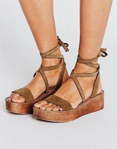 Cute tan wedged sandals.