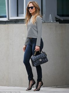 Fresh look: The 44-year-old superstar looked well put together in skinny jeans, a black and white top with stripes, sky high heels and a Cha...