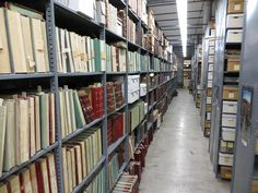 Looking down the main aisle of the Wyoming State Archives South, our off-site storage building. The bound volumes are county clerk record books from across the state.