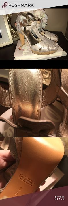 Coach Gold Heels These Coach high heel sandals are fabulous! They are a brushed gold leather with a cork heel and are a size 8. They have never been worn and are from my personal collection. A fabulous find! ❤️ Coach Shoes Heels