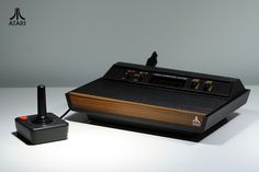  Atari 2600   One of the first Atari game consoles from begining of eighties. Atari 2600 in wooden look.