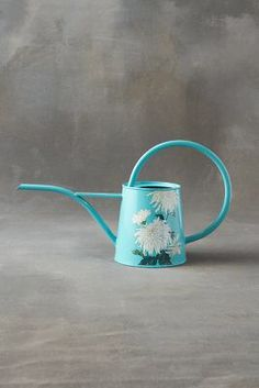 Anthropologie Chrysanthemum Steel Watering Can https://www.anthropologie.com/shop/chrysanthemum-steel-watering-can?cm_mmc=userselection-_-product-_-share-_-42554378