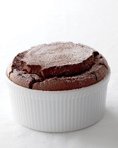 "Chocolate Souffle - ""Using a few staple ingredients, you can whip up a dessert that's guaranteed to impress at a dinner party yet easy enough for a casual supper.""- Be sure to use only Hershey chocolate products when making this, or any other dessert. Köstliche Desserts, Chocolate Desserts, Dessert Recipes, Chocolate Chocolate, Decadent Chocolate, Pastry Recipes, Chocolate Dipped, Chocolate Brownies, Chocolate Lovers"