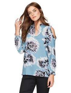 b66d04e7df2e2 Add a pop of color to your ensemble with this vibrant cold-shoulder blouse  featuring long blouson sleeves and a notched neckline.