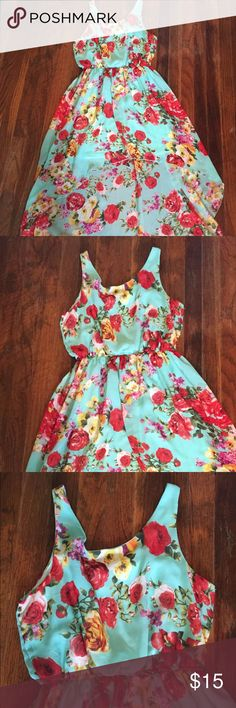 "F21 Floral High/Low Dress SZ M F21 Floral High/Low Dress SZ M teal, red, and yellow floral dress 26"" bust to bottom in front. 42"" back top to bottom. 100% polyester Forever 21 Dresses High Low"