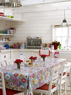 Lots of color brightens up a white kitchen.:
