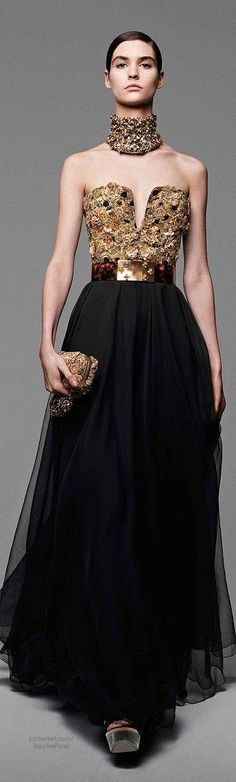 How awesome is this??Alexander McQueen jag ladies black jewelled gown
