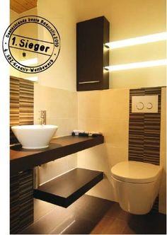 So überraschend kann ein kleines Gäste-WC aussehen. Warm und wohnlich – von Langeweile keine Spur.