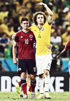 David Luiz (Brazil, right) consoling James Rodriguez (Colombia, left) after the game, and urging the crowd to acknowledge Rodriguez for a stellar World Cup performance. Brazil Colombia, quarter-final FIFA World Cup 2014 Brazil James Rodriguez Colombia, Football Drills, Football Soccer, Football Icon, Football Stuff, Soccer Stars, Sports Stars, Fifa, James Rodriquez