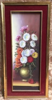 E. MALVAEZ SIGNED OIL ON BOARD STILL LIFE PAINTING SET IN A GILT FRAME WITH BURGUNDY VELVET MAT. SHOWS A BIT OF WEAR AND A BIT OF DAMAGE IN THE BOARD TO THE FAR LEFT. 32H X 15W