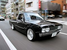 Datsun 620 Pickup  We have a Nissan 720... would love to have it running and slick like this!