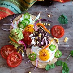 Huevos Rancheros With Guacamole And Refried Beans via @feedfeed on https://thefeedfeed.com/lorindabreeze/huevos-rancheros-with-guacamole-and-refried-beans