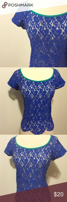 """Royal Blue Lace Blouse Scope neck, cap sleeves, Jade green trim on neckline, scalloped hem and exposed back zipper. Boxy fit.   100% poly  Hand wash   38"""" bust  21"""" overall length Speechless Tops Blouses"""