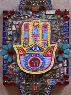 Mosaic Retablo with handpainted Hamsa center. Retablo was mosaiced with shards of Polish Pottery compliments of Marilyn Chaney. Thank you Marilyn, the pottery is alway beautiful