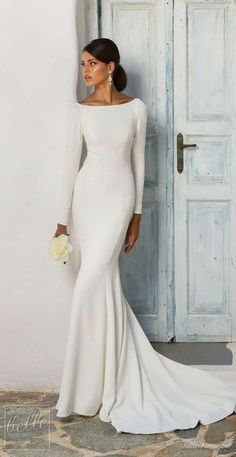 Simple Wedding Dresses Inspired by Meghan Markle | Long sleeve wedding Dress by Justin Alexander | Royal wedding bridal gown #weddingdress #weddingdresses #bridalgown #bridal #bridalgowns #weddinggown #bridetobe #weddings #bride #weddinginspiration #dreamdress #fashionista #weddingideas #bridalcollection #bridaldress #fashion #dress See more gorgeous bridal gowns by clicking on the photo