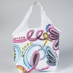 a fabric hobo bag with dye, fabric markers and dimensional fabric paint.