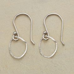 """WHITE GOLD COOPERATIVE HOOP EARRINGS�--�A pair of handmade white gold hoop earrings, with polished hoops of 14kt white gold yield willingly to Anne Sportun 's hammer, assuming the shape most pleasing to her eye. French wires. Exclusive. 7/8""""L."""
