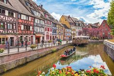 Beautiful view of the historic town of Colmar, also known as Little Venice, with tourists taking a boat ride on canal, Alsace region, France - Stock Image Beautiful Sites, World's Most Beautiful, Budapest, Lago Moraine, Rue Pietonne, Bora Bora, European Destination, Lofoten, Menorca