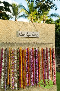 Guests were greeted with flower leis from a traditional Hawaiian lei stand and were assisted in selecting the perfect lei. Four Seasons Resort Hualalai