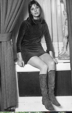 Jane Birkin wears a velvet mini dress with knee-high suede boots