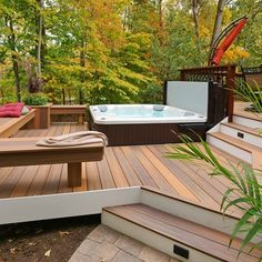 This curved deck is tucked into the woods for lots of privacy. It feature a main deck area and a lower deck dedicated for the hot tub. Skirting is around the main deck and here Fiberon composite decking is used run vertical. Hot Tub Backyard, Backyard Patio, Whirlpool Deck, Deck Pictures, Lower Deck, Composite Decking, Building A Deck, Building Plans, Pergola Patio