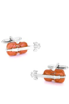 Viola cufflinks for the avid musician or string player. Intricately crafted with brass and shiny rhodium-plating, you'll want these on your sleeves as a colourful addition to your classy outfit.