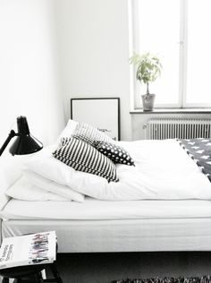 black and white very simple. this idea of a  room would prob b very inexpensive and good for a dorm or something