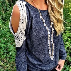 Lace shoulders. Look like they're made from collar lace. Would be a great way to show off my tattoo sleeves.