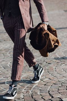 Dressing down a suit with a pair of Sk8-Hi's.
