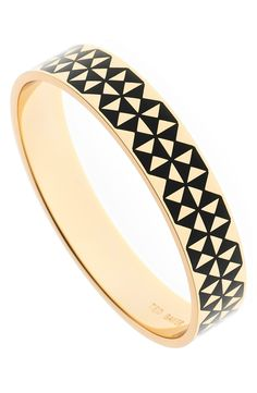 Sleek enamel creates a bold, geo-inspired pattern on this gleaming gold bangle that makes an ultra-modern addition to the bracelet stack.