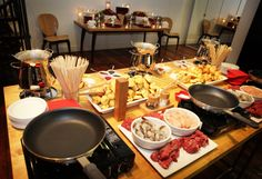 Fondue party: Meat fondue station with chicken, steak, sausage and prawns