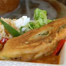 Authentic Mexican Chili Rellenos Recipe - Slightly spicy Anaheim chiles are stuffed with Mexican cheese, rolled in flour and beaten egg, and pan-fried until golden brown in this authentic recipe handed down for generations. Authentic Mexican Recipes, Mexican Food Recipes, Diabetic Recipes, Yummy Recipes, Healthy Recipes, Stuffed Anaheim Peppers, Stuffed Peppers, Tamales, Tostadas