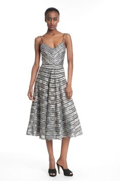 Yelena Flared Slip -  This tarnished silver dress is fun and flowy, while also having a sense of elegance! Going to an event, or just out with friends? This versatile creation works either way!