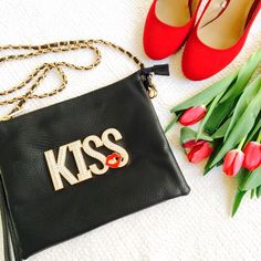 "NWOT Adorable ""Kiss"" Black Purse/Clutch HOST PICK - ""A-LIST STYLE""!!! OFFERS WELCOME. PLEASE USE THE OFFER BUTTON. I do not negotiate price in the comments. So cute!! Faux leather clutch that has a detachable strap and can also be worn as a purse. Crystals on the letters. Goldtone hardware. Zip top. 10.5"" wide. 8.25"" long. Handle drop is 24"". NWOT- never used, in new condition. Bags Clutches & Wristlets"