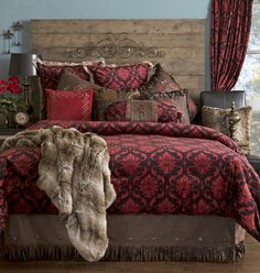 The red damask comforter is accentuated by the rich looking accents in this western bedding collection. The faux leather tailored bed skirt is embellished with western studs and fringe while the wide array of pillows creates interest and intrigue. Red Bedding Sets, Rustic Bedding Sets, Western Bedding, Queen Bedding Sets, Luxury Bedding Sets, Comforter Sets, Country Bedding, King Comforter, Damask Bedroom