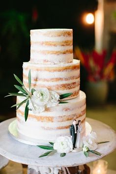 """We take our dessert very seriously, so I had Christine Johnston at Confections by Christine, in my hometown of Vancouver, bake a stunning 'dirty, naked cake' that one of my (very generous) guests took on the airplane to L.A.!"" says Jessi. ""We topped it with an antique wedding-cake topper and our florist, Heather, added some gorgeous fresh flowers."""