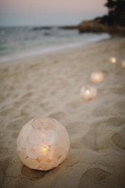 """paper or lace glued on the outside of glass """"flame-less"""" candle holders - outdoor reception"""