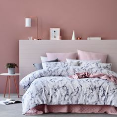 Beautiful bedroom design with pink walls and small modern bedside table