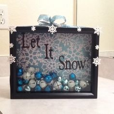 "DIY Seasonal Shadow Boxes. ""Let it Snow"" w/ jingle bells and snowflake scrapbook paper."