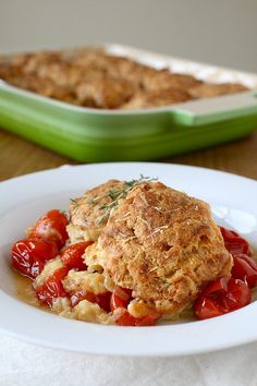 Tomato Cobbler with Gruyere Biscuits - I'm not big on tomatoes but this looks pretty damn tasty.