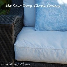 DIY tutorial for recovering old outdoor cushions with inexpensive drop clothes.  NO SEW!