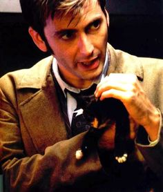 Tall, Skinny, and Scottish Bloke.  David Tennant.  ... with a KITTEN!!!  Just when you thought he couldn't get any cuter!