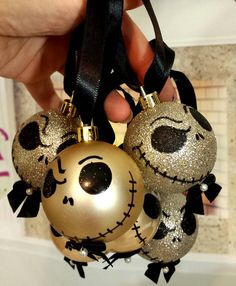 This sale is for a box of 6 hand painted nightmare before Christmas plastic ornaments with hand made Black satin ribbon bow tie with pearl on each ornament. Black satin ribbon hooks Jack head : approximately 2 gold bulb Hook: 2 Silver Christmas Decorations, Christmas Tree Themes, Christmas Tree Ornaments, Ornaments Ideas, Gold Ornaments, Christmas Centerpieces, Black Christmas, Disney Christmas, Christmas Diy