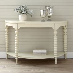 Parish Console Table   The eye-catching turned spindle legs on the Parish Console Table showcase quality craftsmanship and attention to detail. Curves continue throughout the design with a shaped apron and semicircle silhouette, while a crisp white finish keeps the look light and fresh.