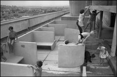 Le Corbusier - Unite Marseilles Children playing on the roof landscape using the (concrete) architecture as their playground. Le Corbusier, Magnum Photos, Adaptive Reuse, Photographer Portfolio, Outdoor Playground, Roof Repair, Marseille France, Ara, Children