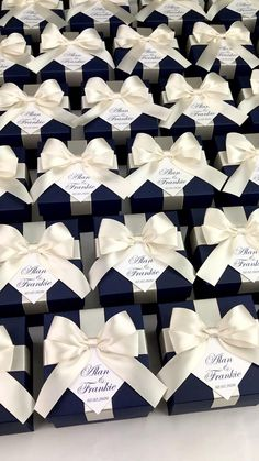 Elegant navy blue wedding favor box with champagne satin ribbon bow and custom names, Elegant personalized gift boxes make a unique way to thank guests for attending your special day. Wedding Favours Navy Blue, Champagne Wedding Favors, Wedding Candy Table, My Wedding Favors, Handmade Wedding Favours, Destination Wedding Welcome Bag, Wedding Gift Boxes, Wedding Gifts For Guests, Personalized Wedding Favors