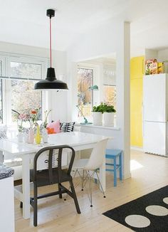 Dining in kitchen. White to make it look bigger