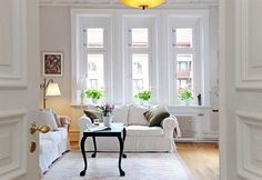 Love the cleanness of this living room, the colors (similar to my space), and slouchiness of the couch.